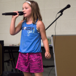 Camper Sings at Music Summer Camp