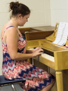 Camper Practicing Piano at Music Summer Camp