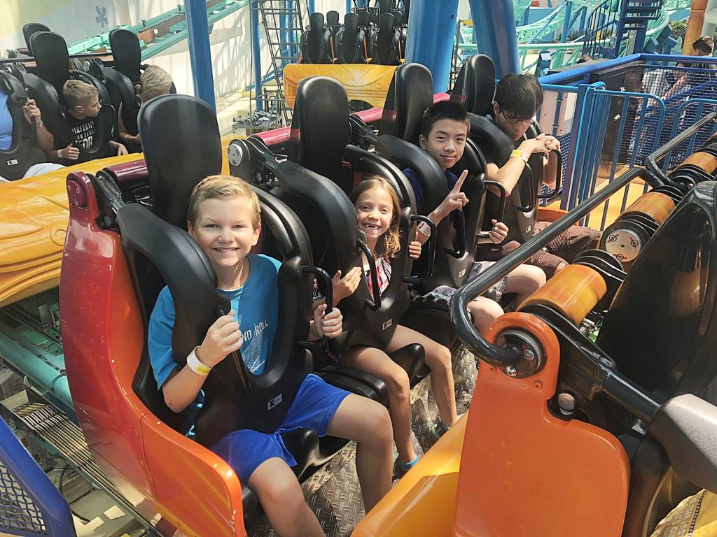 Minnesota Summer Camp campers enjoying rides on adventure day