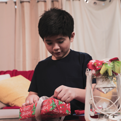 Boy Opening Christmas Gifts