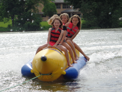 Summer Camp in America - Campers Enjoying Banana Boat Ride